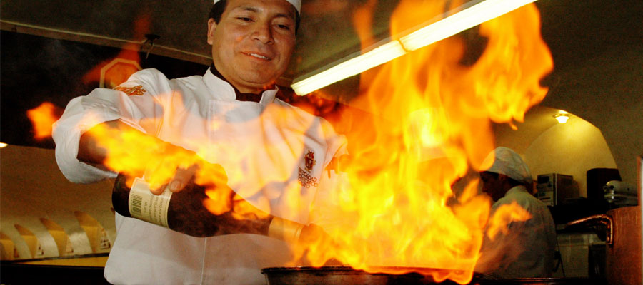 A Chef Flambeing with Wine